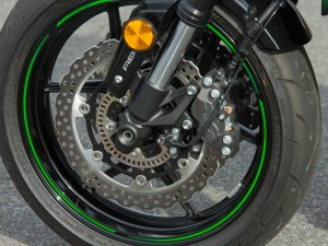Up front, a pair of opposed 4-piston calipers squeeze petal-style rotors, and ABS is standard.